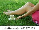 girls legs lying in grass... | Shutterstock . vector #641126119