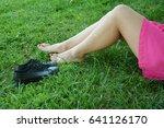 girls legs lying in grass... | Shutterstock . vector #641126170