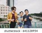 happy young people with wide... | Shutterstock . vector #641128954
