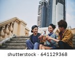 happy asian friends sitting on... | Shutterstock . vector #641129368