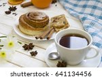 pastry and cups of tea on white ...   Shutterstock . vector #641134456