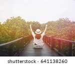asian woman sitting on the wood ... | Shutterstock . vector #641138260