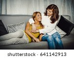 mother and doughter sitting on... | Shutterstock . vector #641142913