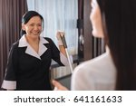 happy positive chambermaid... | Shutterstock . vector #641161633