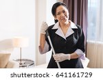 delighted positive chambermaid... | Shutterstock . vector #641161729