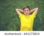 happy teenage boy  lying on the ... | Shutterstock . vector #641172814
