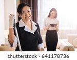 Joyful Positive Hotel Maid...