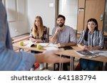 handsome man sitting between... | Shutterstock . vector #641183794