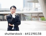 asian business man standing at... | Shutterstock . vector #641198158