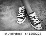 close up of sneaker and woman's ... | Shutterstock . vector #641200228