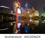 Small photo of MACAU, CHINA - APRIL 23, 2017: The lights of a famous Casino operator Wynn reflect on water with the Grand Lisboa casino in the background. Macau recently surpassed Las Vegas for gambling revenue.