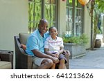 african american father and son ... | Shutterstock . vector #641213626