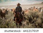 Cowboy Leading Horse Herd...