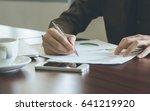 businessman analyzing graph... | Shutterstock . vector #641219920