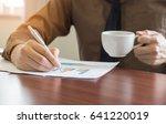 businessman analyzing graph... | Shutterstock . vector #641220019