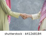 two arabian business  handshake ... | Shutterstock . vector #641268184
