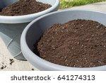 potting soil in large gray pots   Shutterstock . vector #641274313