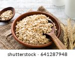 rolled oats or oat flakes in... | Shutterstock . vector #641287948