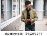 african american man ysing phone   Shutterstock . vector #641291344