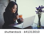 asian  woman working with her...   Shutterstock . vector #641313010
