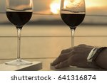 two glasses of wine at sunset... | Shutterstock . vector #641316874