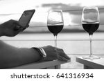 sipping red wine at sunset on... | Shutterstock . vector #641316934