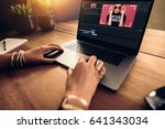 woman editing video on laptop... | Shutterstock . vector #641343034