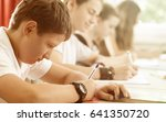 students or pupils writing test ... | Shutterstock . vector #641350720