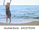 lovely girl jumping on the... | Shutterstock . vector #641379244