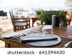 Small photo of leisure, travel and tourism concept - served table at open-air restaurant on beach