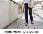 retired woman enjoying promenade | Shutterstock . vector #641429908
