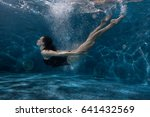 Woman Floats Under Water In Th...