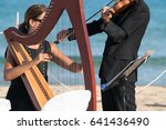 harp and violin concert at the... | Shutterstock . vector #641436490