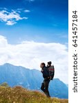 father hiking with child in... | Shutterstock . vector #641457184