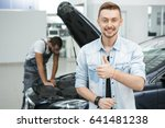 young happy male car owner... | Shutterstock . vector #641481238