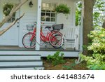 small town usa   red bicycle... | Shutterstock . vector #641483674