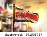 Costa Rica Flag Against City...