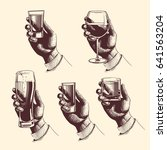 hands holding glasses with... | Shutterstock . vector #641563204