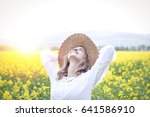 young woman in a rape field | Shutterstock . vector #641586910