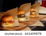 delicious burgers on craft... | Shutterstock . vector #641609878