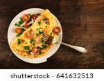 a photo of an omelette with... | Shutterstock . vector #641632513