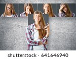 Small photo of Young european female hiding herself behind poster with smiling face. Row of faces with different expressions in the background. Emotion concept