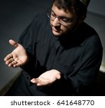 muslim arabic man praying | Shutterstock . vector #641648770