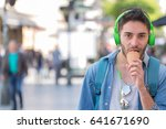 close up of a man eating ice... | Shutterstock . vector #641671690