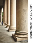 Small photo of Lonely Woman besides pillars at the Harvard University in Massachusetts