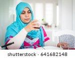 muslim woman enjoying food in... | Shutterstock . vector #641682148