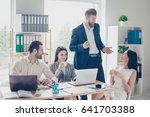 happy excited colleagues in... | Shutterstock . vector #641703388
