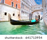 Traditional Gondolas Passing...