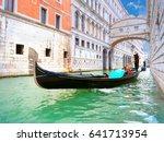 Traditional Gondolas Passing...