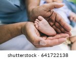 father holding his son's... | Shutterstock . vector #641722138